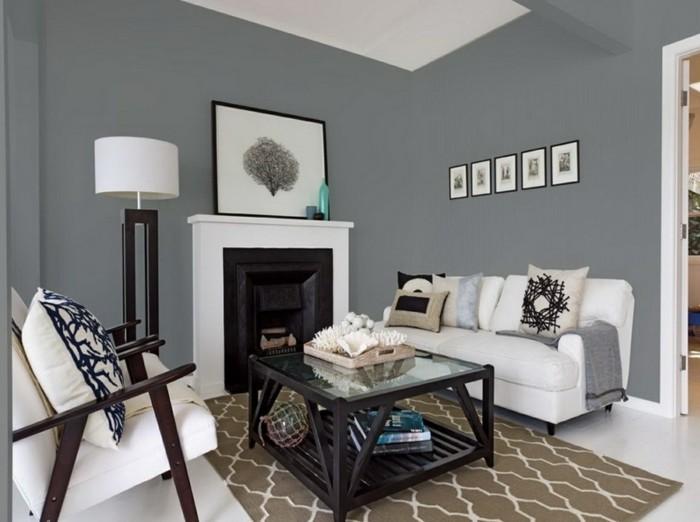 wohnzimmer grau mit weißen möbelstücken und dunkelbraunen akzenten
