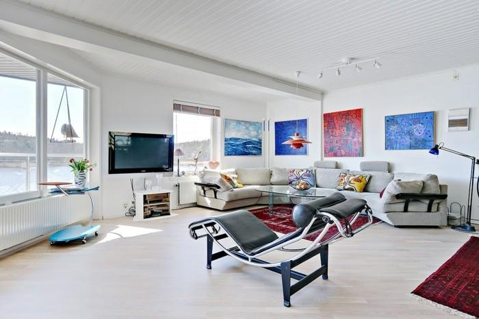 dekoideen wohnzimmer wandbilder weiße wände rote teppiche
