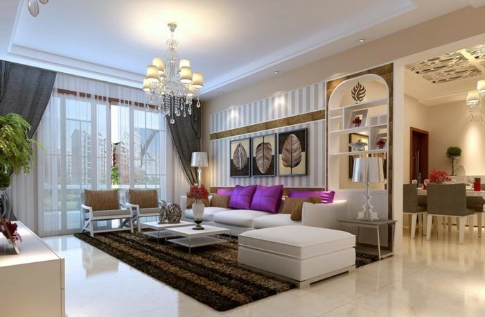 lampen wohnzimmer abgehängte decke leuchter eleganter teppich lila akzente pflanzen