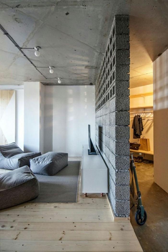 wohneinrichtung ideen beton graue möbel holzboden