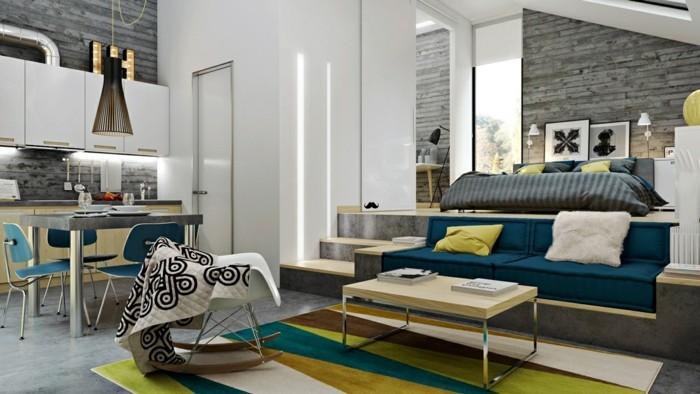wohneinrichtung ideen wohnzimmer einrichten weiße betonwand farbiger teppich
