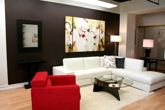 wohnideen wohnzimmer farbiges gemälde roter sessel und weißer teppich