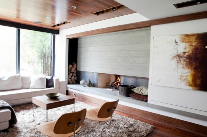 wohnideen wohnzimmer modernes wanddesign und gemütlicher kamin