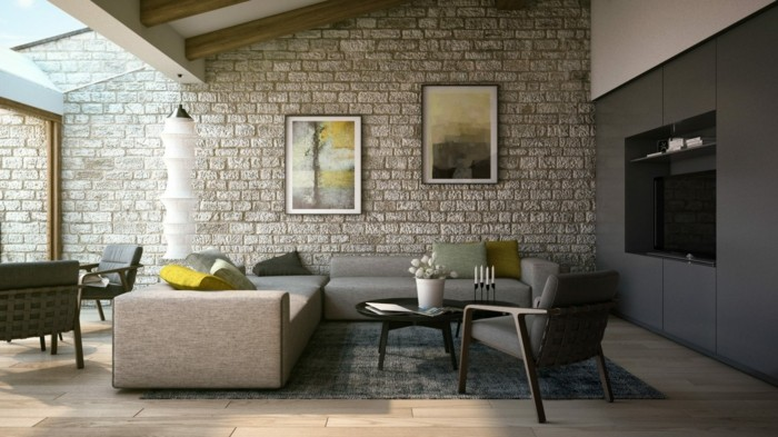 wohnideen wohnzimmer steinwand mit schönen bildern