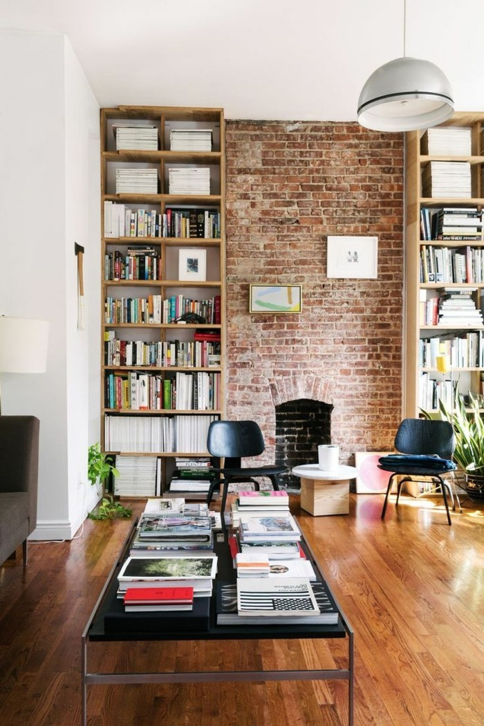 wohnung dekorieren dekoideen wohnzimmer ziegelwand bücher überall