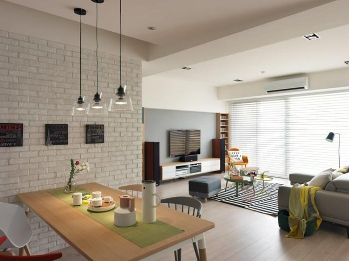 inneneinrichtung wohnideen wohnzimmer ziegelwand streifenteppich