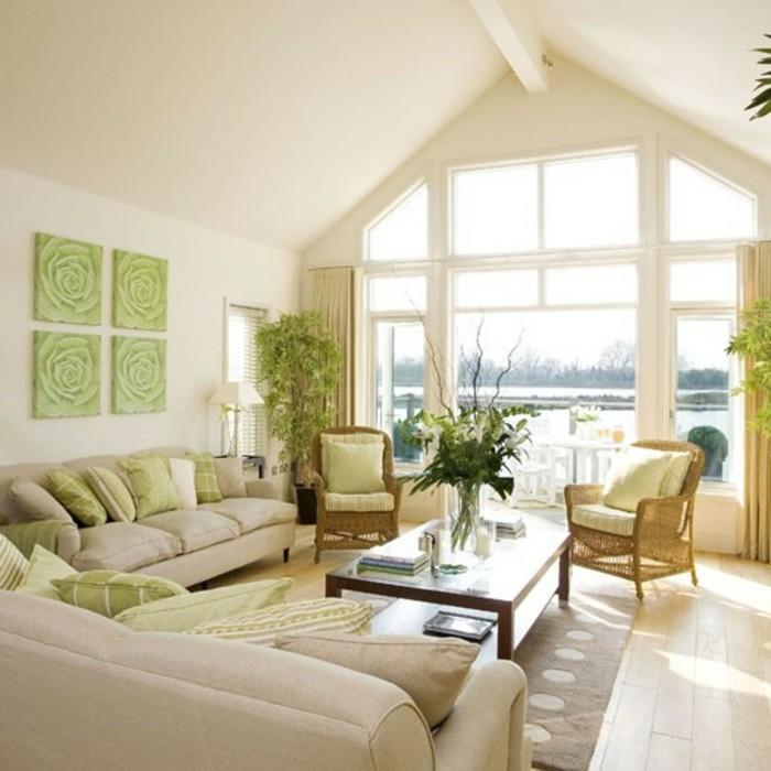 inneneinrichtung wohnzimmer grüne akzente rattansessel holzboden
