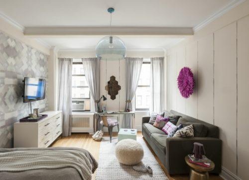 kleine-wohnung-einrichten-einzimmerwohnung-retro-stil-polstermobel-sofa-pouf-sideboard