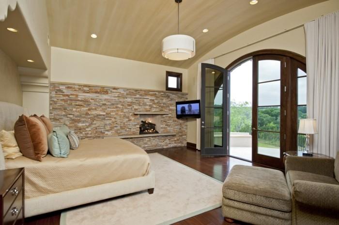 natürlich wohnen schlafzimmer steinwand teppich