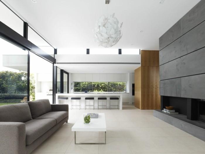 natürlich wohnen wohnzimmer einrichten bodenfliesen graues sofa panoramafenster
