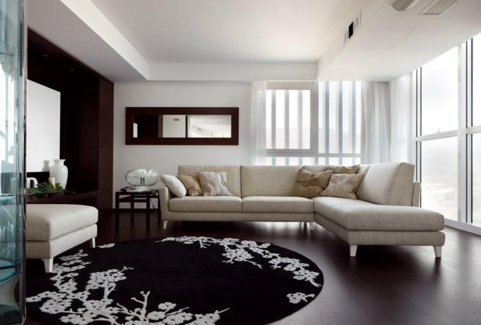 runde teppiche wohnzimmer gestalten schwarz weiße florale motive ecksofa