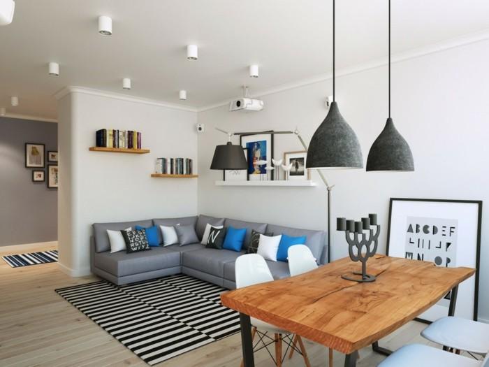skandinavisch wohnen wohnbereich streifenteppich hängelampen rustikaler esstisch