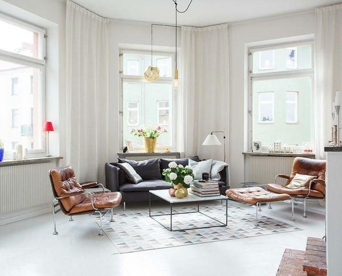 skandinavisch wohnen wohnzimmer ideen geometrischer teppich ledermobel pflanzen