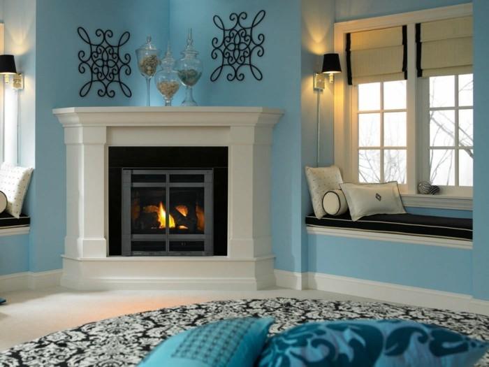 teppich rund wohnbereich kamin blaue wandfarbe gemütlich
