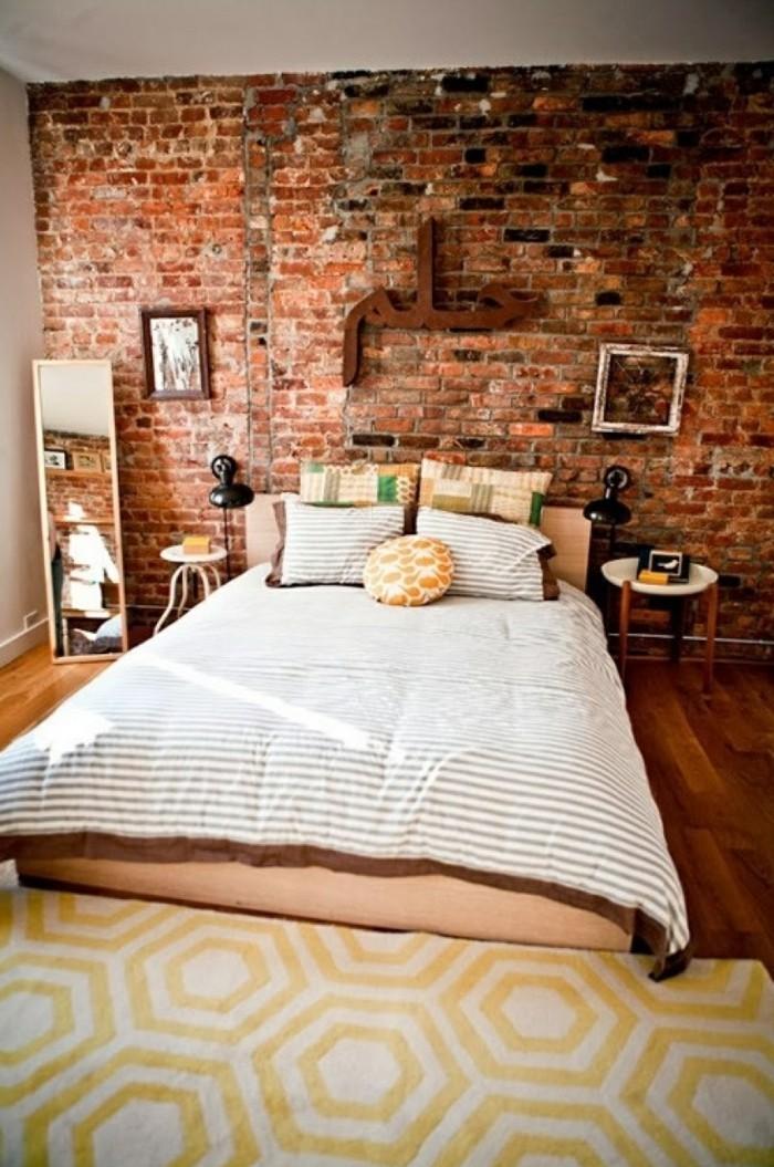wandgestaltung ideen schlafzimmer ziegelwand geometrischer teppich