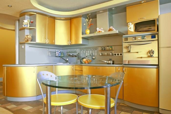 wohnideen küche gelb glanz gläserner tisch