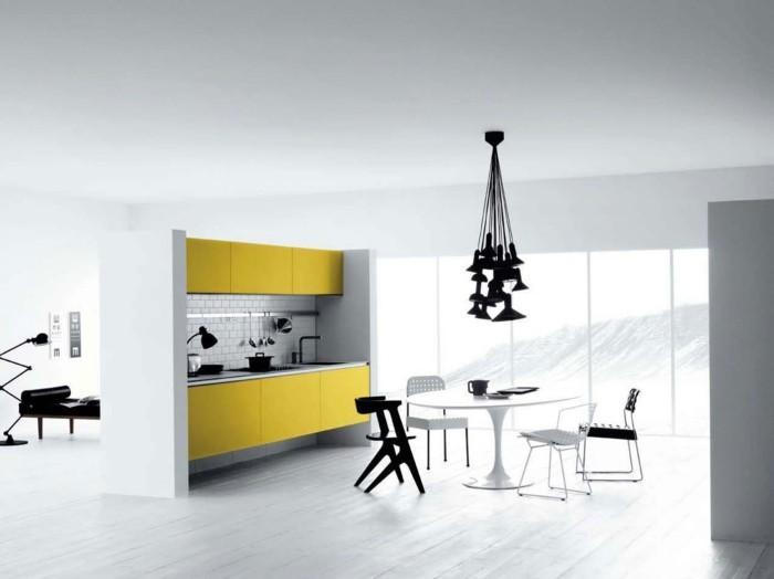 wohnideen küche minimalistisch gelbe küchenschränke weißer runder tisch