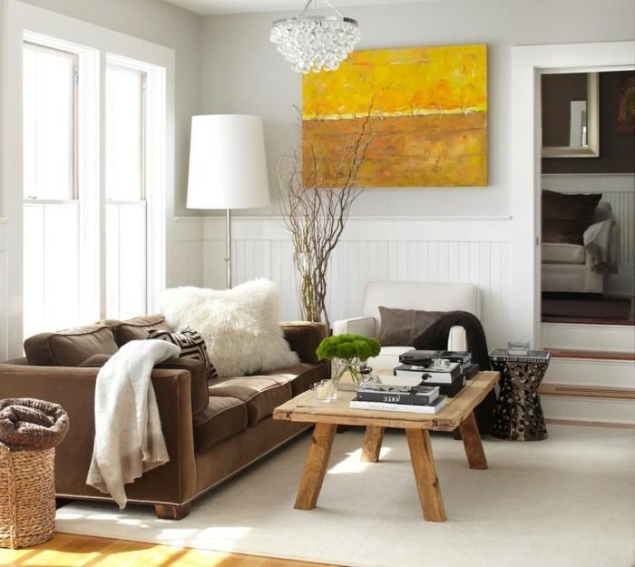 wohnung einrichten ideen wohnbereich holztisch braunes sofa weißer teppich
