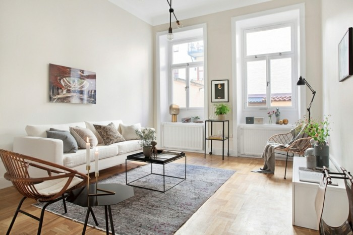 wohnung einrichten ideen wohnideen wohnzimmer skandinavisch grauer teppich weißes sofa kerzen pflanzen