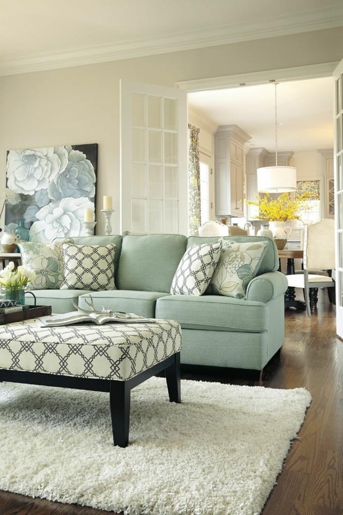 wohnung einrichten ideen wohnzimmer umweltstil grünes sofa dekokissen muster