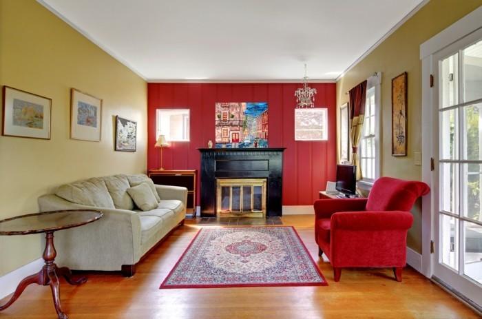 wohnzimmer hellgelb:wohnungseinrichtung wohnzimmer hellgelbe wand roter sessel runder