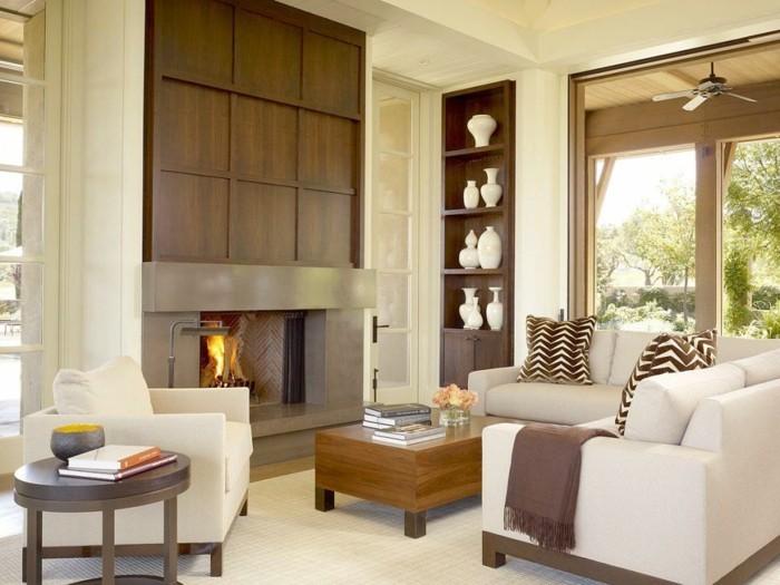wohnungsgestaltung wohnzimmer kamin heller teppich schöne dekokissen