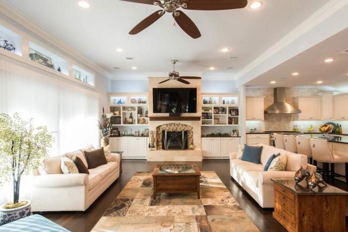 hausrenovierung wohnzimmer kuche offener plan deckenventilator teppich weise sofas