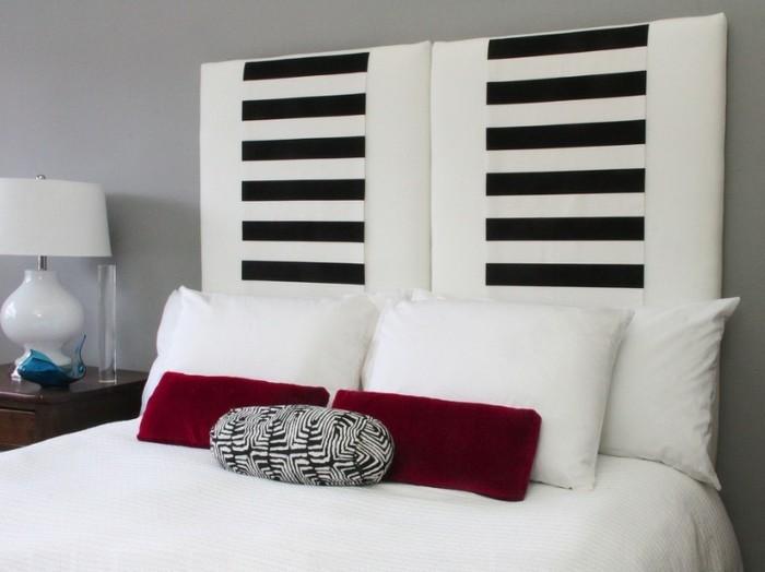 schlafzimmer gestaltung bettkopfteil teppichläufer rote dekokissen