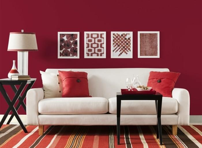 wohnideen wohnzimmer rote wände weißes sofa streifenteppich