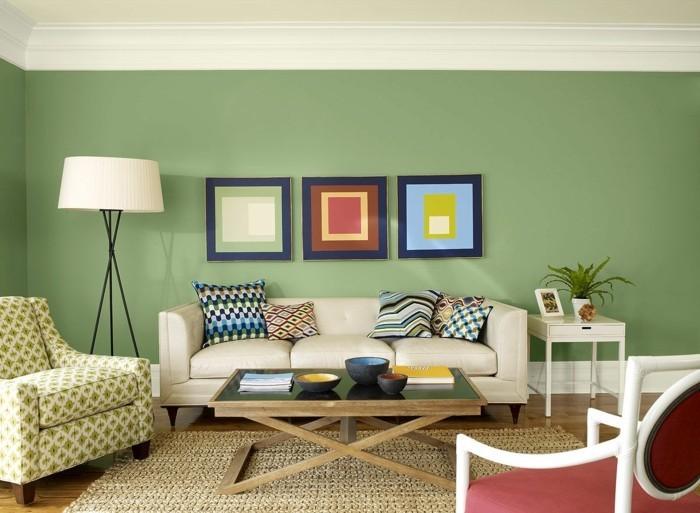 wohnzimmer gestaltung grüne wände dekokissen sisalteppich