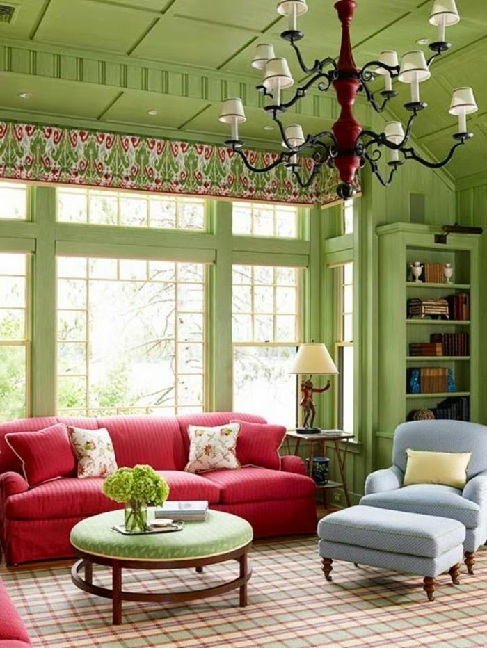 wohnzimmer gestaltung grüne wandfarbe rotes sofa