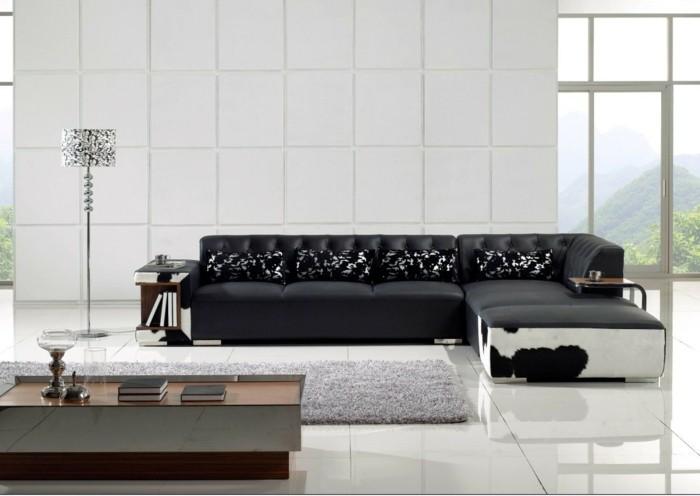 moderne sofas gepolstert ledercouch schwarz tierprints kissen hochflorteppich