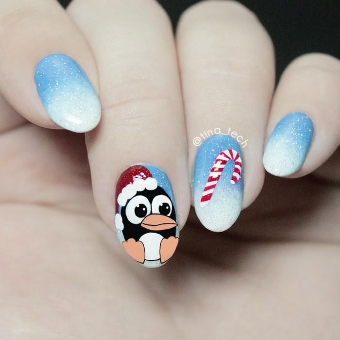 nageldesign ideen winter weihnachtliche fingernaegel pinguin