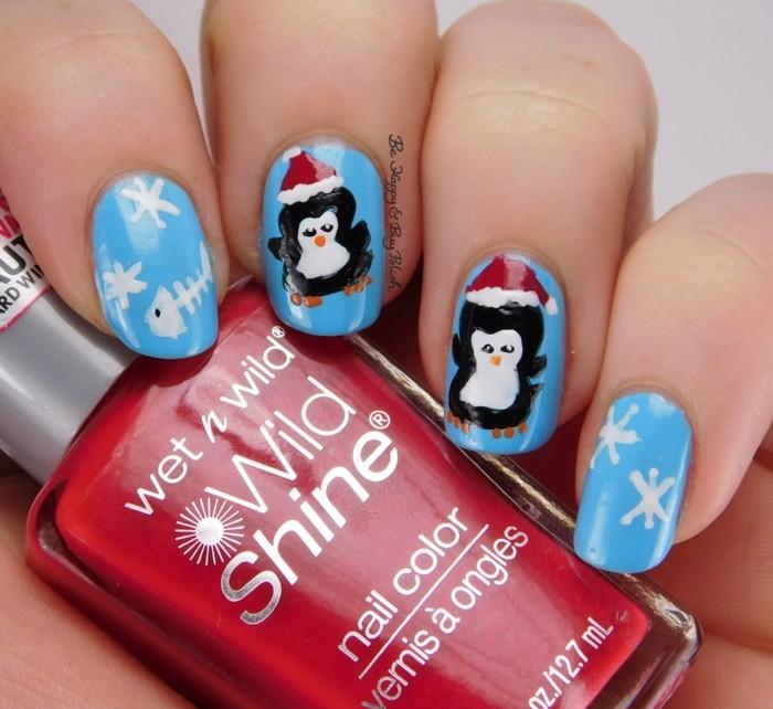 nageldesign winter weihnachtsmotive festliche fingernaegel piguinen