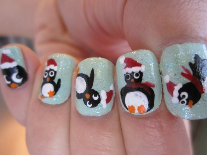nageldesign winter weihnachtsmotive pinguinen fingernaegel ideen