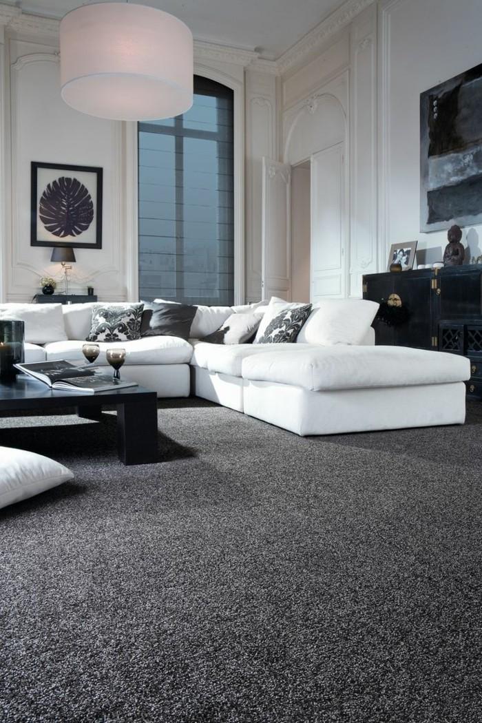 wohnideen wohnzimmer dunkelgrauer teppich weisse bodenkissen stilvolles innendesign