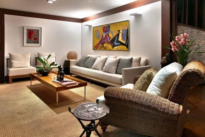 wohnideen wohnzimmer flechtmoebel sisalteppich orchidee dekokissen