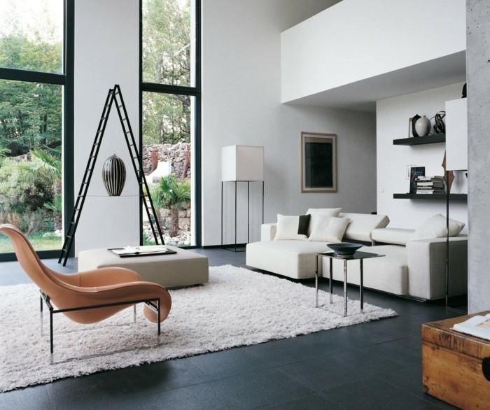 Design Mobel Wohnzimmer wohnzimmer gestalten grau design beton wand stuehle orange akzent Design Wohnzimmer Design Mbel Wie Man Sich Designer Mbel Leisten Kann