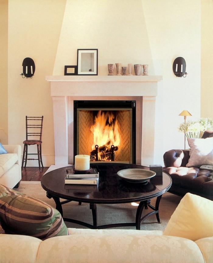 kamine brennholz runder couchtisch sofa kaminsims wohnzimmer