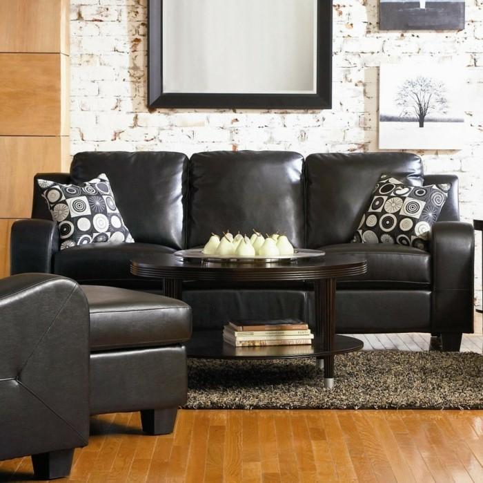 moderne sofas schwarzes ledersofa beiger teppich dekokissen dekoideen