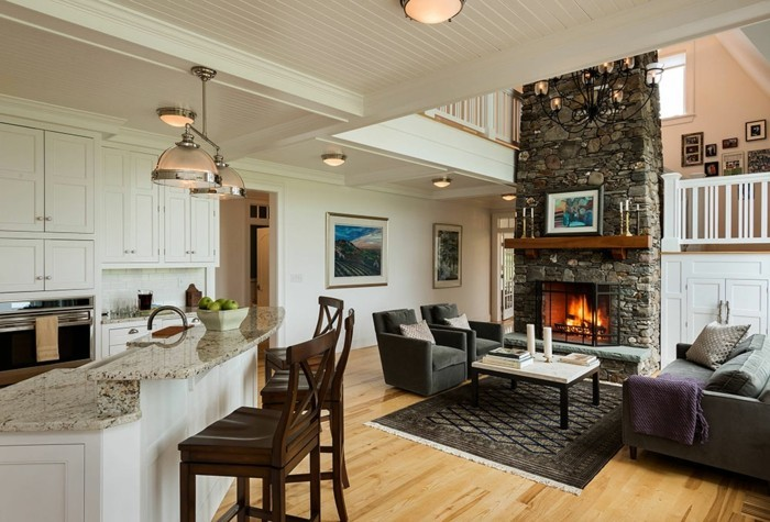 wohnungseinrichtung ideen wohnzimmer wohnbereich kamin wandverkleidung naturstein kueche theke marmor