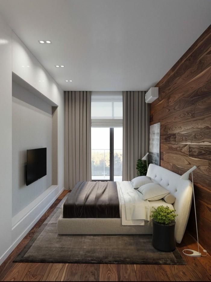 wohnideen schlafzimmer kleiner schlafbereich mit holzpaneelen