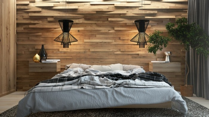 wohnideen schlafzimmer moderner schlafbereich mit holzpaneelen und schwarzen hängelampen