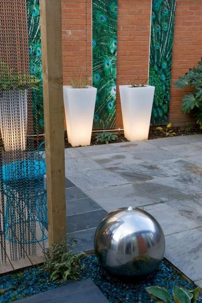 gartenbeleuchtung ideen leuchtende pflanzenbehälter gartenbrunnen