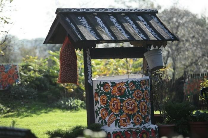 hausfassade gestalten zalipie florale muster brunnen