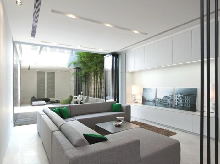 led lichtleiste wohnzimmer beleuchten ideen grüne dekokissen