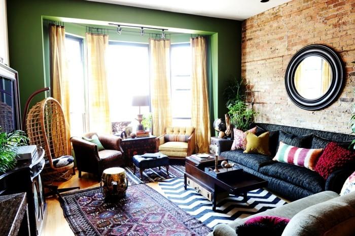 wohnideen wohnzimmer grüne wandfarbe dunkles sofa eklektisch