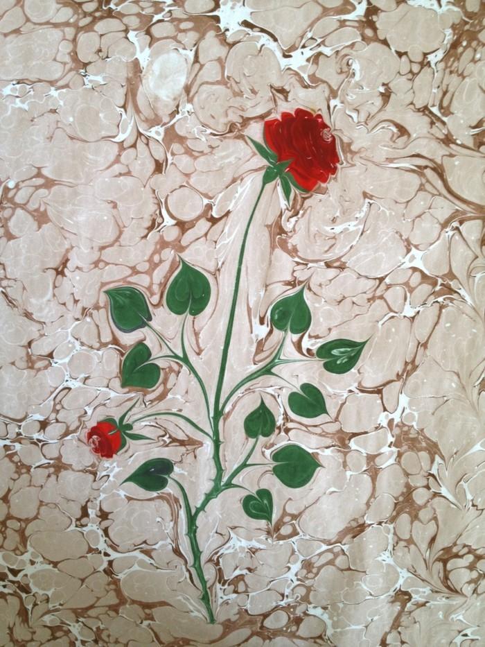 eine rose auf wasser