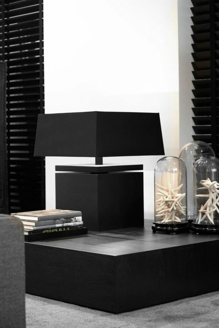 einrichtungsideen wohnzimmer schwarzer couchtisch accessoires