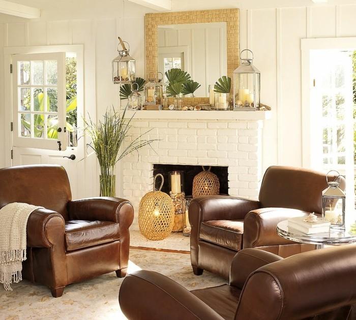 einrichtungstipps ledersessel wohnzimmer ideen kamin laternen kerzen wandspiegel